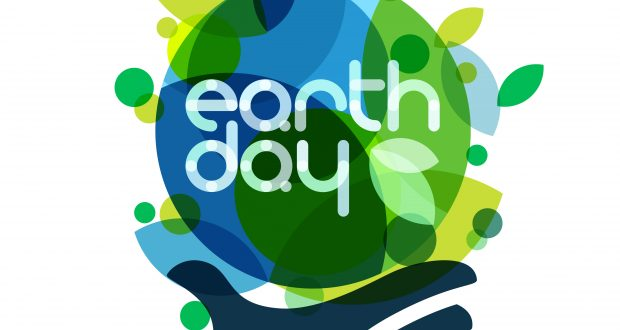 Abstract vector illustration background. Human hand holding green Earth. Concept for save earth day.